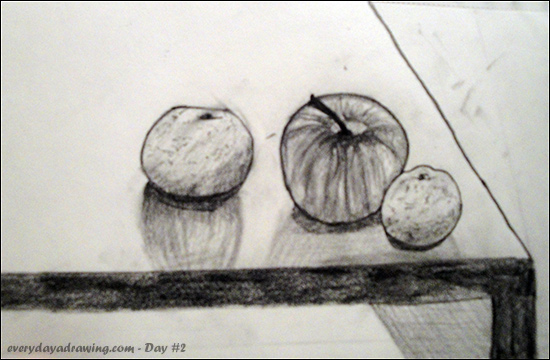 A pencil still life of an apple and two oranges