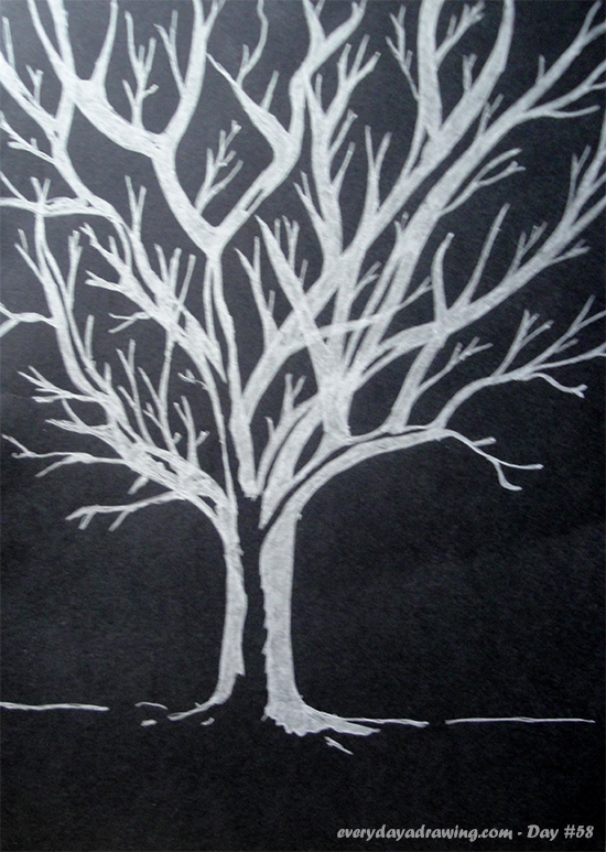 Drawing of a tree in silver metallic pen on black card