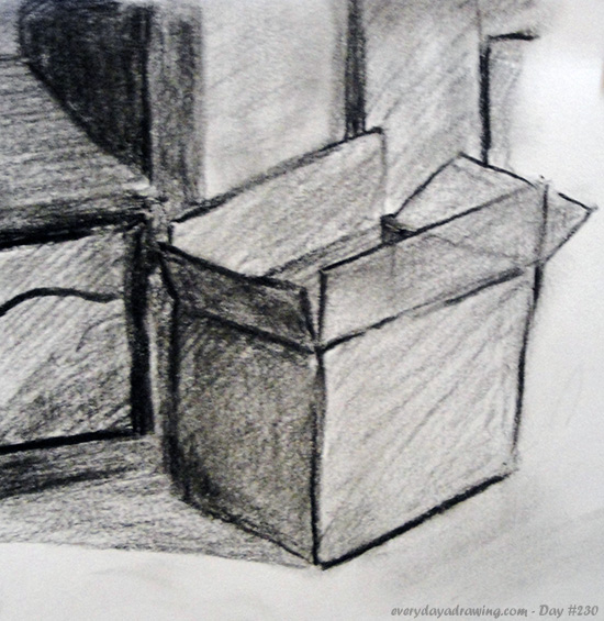 Drawing of a box in charcoal