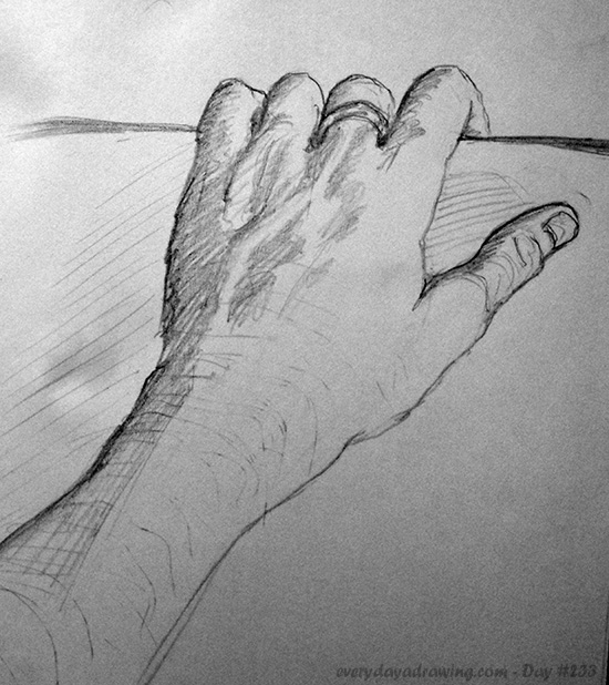 Drawing of my hand holding my sketchbook